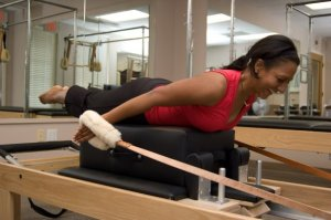 Radhika on the Pilates Reformer